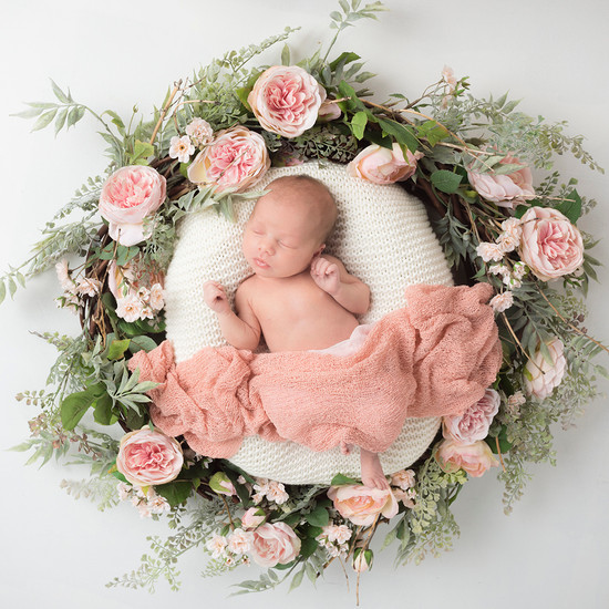 Beautiful newborn photograph of baby in floral wreath. By Emotion Studios photography Shropshire