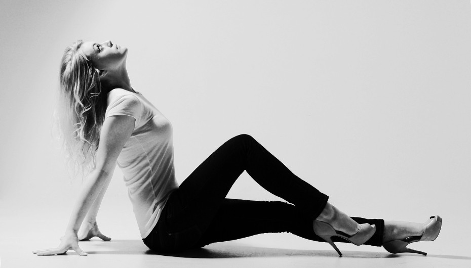 Creative black and white image of women sitting on floor by Emotion Studios.
