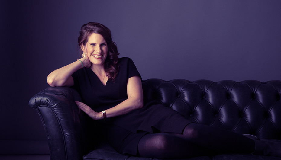 Stunning photograph of women relaxing on leather sofa and smiling. Image taken by Emotion Studios.