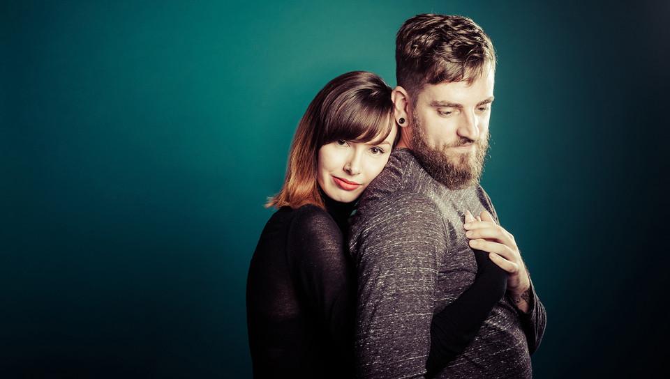 Loving couple embrace. Attractive couple, Studio photograph by Emotion studios.