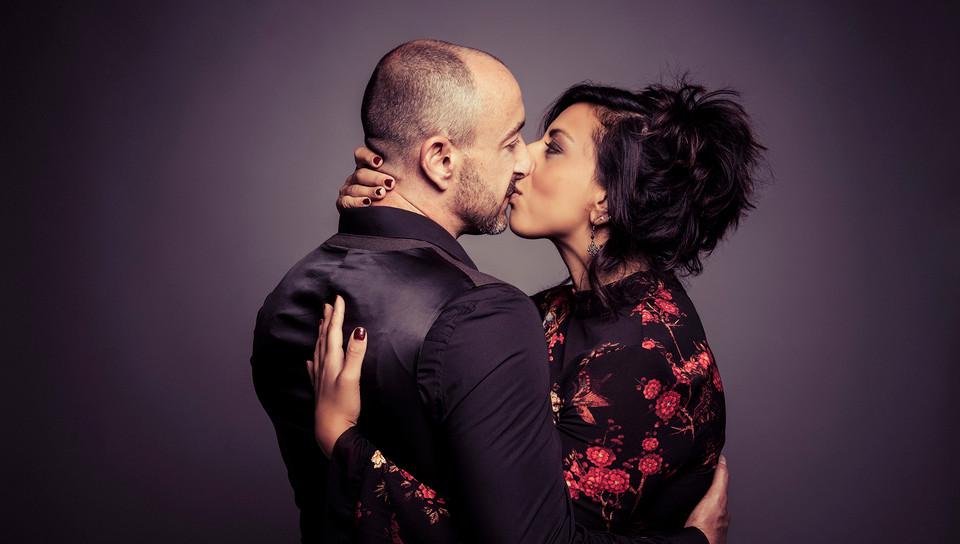Couple boudoir, embrace, kiss. Studio photograph by Emotion Studios West Midlands.