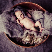 Stunning newborn lying on blanket image by Emotion Studios of Shropshire