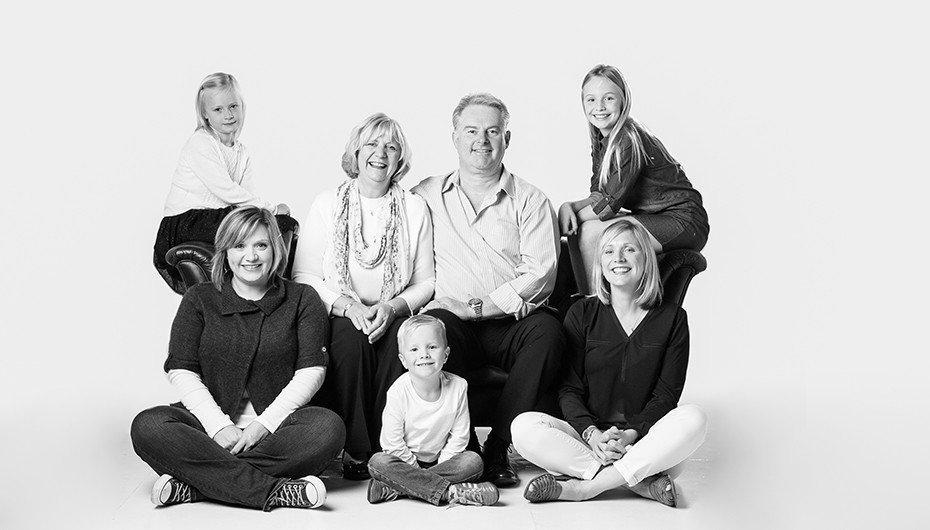 Gorgeous family photograph in black and white in studio. Image by Emotion Studios