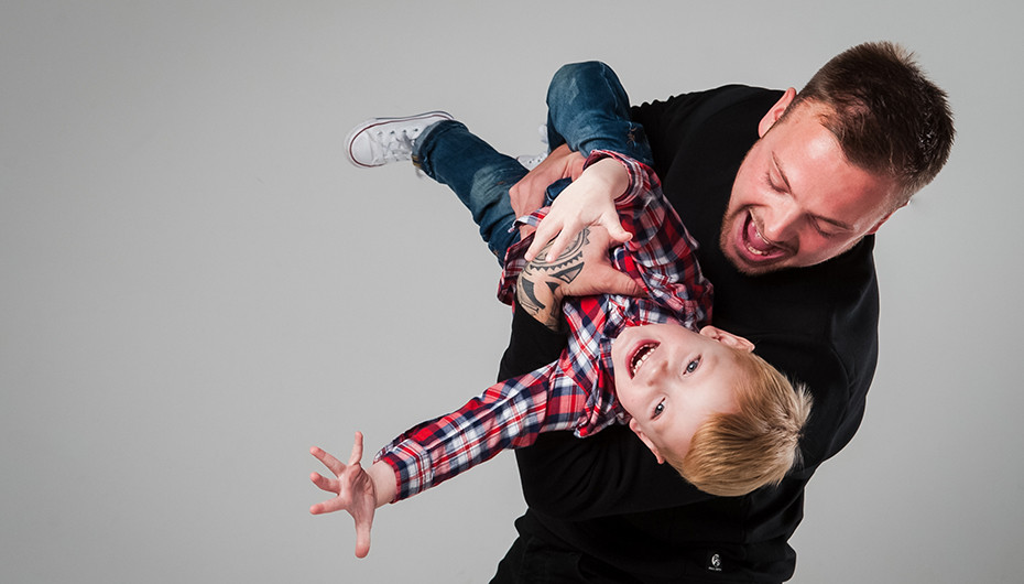 Fun father and son playing photograph taken by Emotion Studios of Claverley