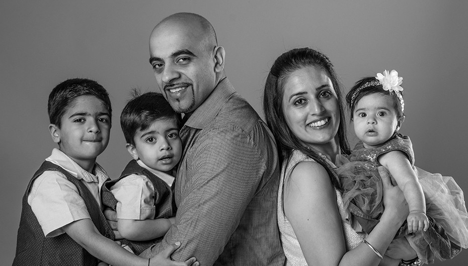 Black and white, happy family portrait. Picture by Emotion Studios.