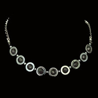 Handmade jewellery of hematite circles with beads and chain necklace