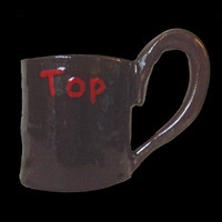 "Handmade clay kinky ""Top"" clay mug in black with red lettering"