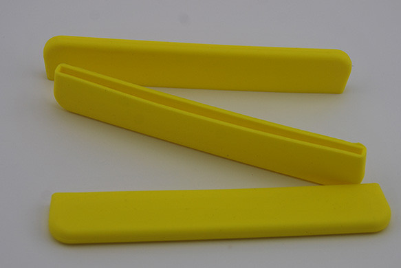 Yellow removable silicon paddle blade tip protector. Durable and lightweight. Protects the blade edge from damage when paddle not in use.