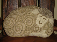 This was hooked and turned into a pillow by Tammy Burks.