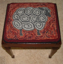 "Punch hooked by Angela Jones.  I made this into a square for a stool top.  The stool is an old ""Home Economics"" stool you would sit on while learning to sew.  The top lifts off to store your sewing tools.  The sheep is natural color rug yarn and the background is hand dyed wool rug yarn."
