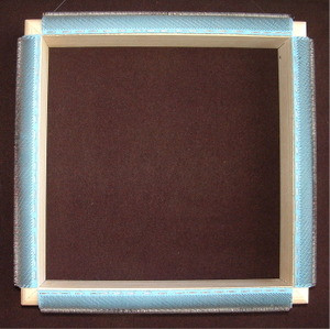 "The Breezy Ridge Rugs Little Traveler with cozy punch needle rug hooking frame is portable, lightweight, and sturdy.  This little frame is great for small punch needle projects or even larger ones. The cozy will protect your arms while punching and protect the grippers when not in use.  Hand crafted fine poplar hardwood Wide inside working area 10"" x 10"" Full length gripper strips on all 4 sides Lifetime guarantee"