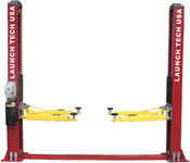 "9,000 lb lifting capacity •Chain Drive •Rubber Door Guards - Provides added security against door damage •Hose Guards - Protects hydraulic hoses from damage •Stackable Foot Pad Extensions - Extra tall applications are no problem with the four 3.5"" extensions •Dual Point Lock Release - Allows technicians to disengage both column locks independently •Heavy-Duty Arm Restraint System - Oversize rugged steel gears, pins, and springs for trouble free operation •Double Telescoping Screw Pads - Used with rubber pads offering 2.5"" adjustment for complete vehicle coverage •Standard Asymmetric - Lift installed with columns facing each other •Rotated Asymmetric - Lift installed with columns offset - rotated"