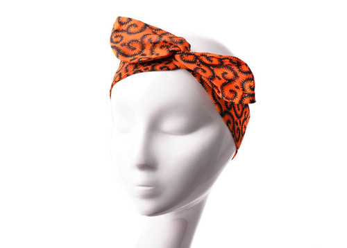 Statement headpieces are a must this season. This design trimmed with our vibrant prints ensures a comfortable fit. Slip it on to give party looks a playful spin. Perfect for casual or dressy days!  Unstretched width 120cm.  100% chiffon fabric.