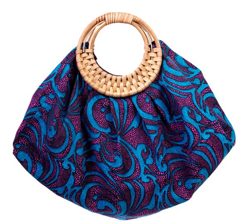 """Our Amy beach Tote bag is made from vibrant print fabric with a handcrafted bamboo cane handle. Perfect accessory for the Beach! """"Best thing about it is it folds up nicely"""" -OK Magazine"""