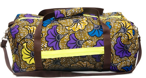 The Zizi duffel bag is designed with the jet-setter in mind. Detailed with neon zips and net sided pocket, this spacious piece is handcrafted from African pattern cotton fabric. It's generously sized to hold a weekend's worth of clothes and has a pocketed interior to keep smaller essentials organized. Carry yours with or without the removable shoulder strap. It also makes an excellent gym bag!   - African patterned fabric - Neon Zip fastening at top and at the sides - Weighs approximately 0.9kg - Made in West Africa