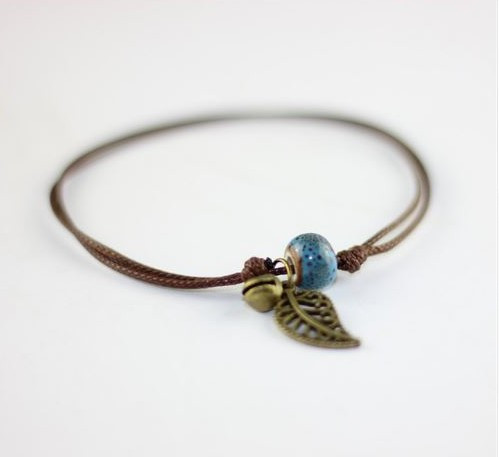 resell for 9.00 or more Boho Anklet Brown Cord, chinese knot, Antiqued brass leaf, bell, blue ceramic bead. Fits 8 to 12 inches Style #BBCAL040518g