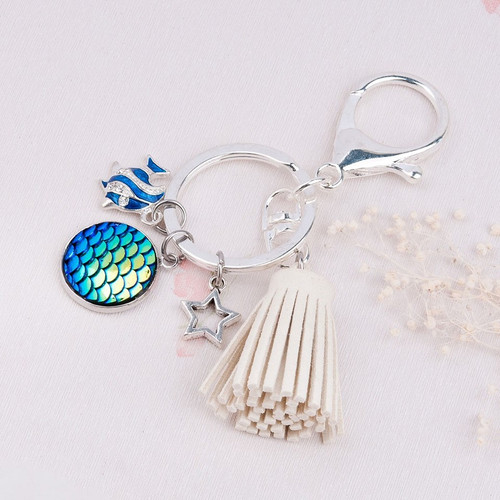 """resell for 15.00 or more Mermaid Fish /Dragon Scale Keychain & Keyring Silver Plated & Silver Tone Off-white & Blue AB Color Faux Suede Tassel Star Clear Rhinestone 94mm(3 6/8"""") x 30mm(1 1/8"""") Style #MFTK042618"""