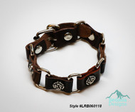 "Bracelet, leather (dyed) / imitation rhodium-plated steel / antique silver-plated ""pewter"" (zinc-based alloy), brown, 22mm wide with 10mm rose, adjustable at 7 and 8 inches with buckle-style closure. Style #LRB060118"