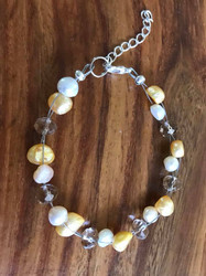 Resell for 15.00 or more 7.5 inch floating bracelet plus ext Yellow and natural fresh water pearls with honey crystal  Made by Ashley Style #YPCFB062618