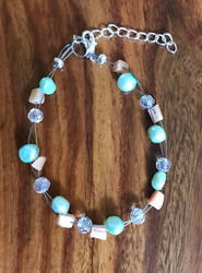 Resell for 5.00 or more 7.5 inch floating bracelet plus extender Light teal fresh water pearls/ coral cats eye glass/ crystal. Made by Ashley Style #CTCFB070318