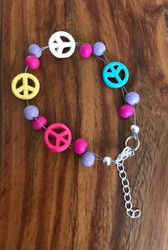 7.5 inch plus ext chain Whimsical peace sign bracelet (colors of peace signs may vary)  Pink purple wood, howlite peace signs Style #WPSFB071318
