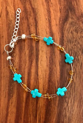 Resell for 15.00 or more 7.5 inch floating bracelet plus extra chain Turquoise magnesite cross w honey glass Style #TMCFB080218