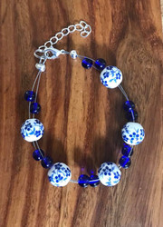 "Resell for 18.00 or more 7.5"" plus extender chain floating bracelet  Ceramic blue and white beads blue glass Made by Ashley Style #BCFB081718"
