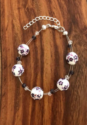 "Resell for 18.00 or more 7.5"" plus ext floating bracelet  Made by Ashley  Purple ceramic w purple glass and crystal Style #PCFB082918"