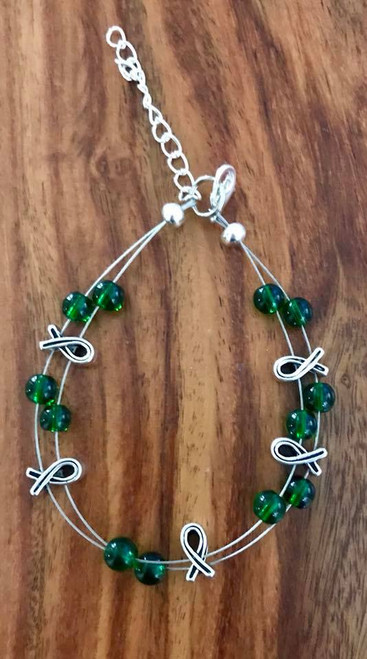 Resell for 21.00 or more (1.00 is donated) 7.5 inch plus ext floating bracelet  Pewter awareness ribbon / green glass Style #GARB091418