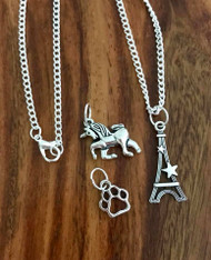 "Resell for 18.00 or more Little girls set 16"" silver tone chain w 3 charms  Pewter paw print, Eiffel Tower, unicorn Style #LGNSUPE091718"