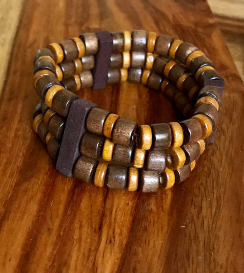 "Resell for 9.00 or more 7 inch stretch bracelet  1"" wide Three tone wood Style #TTWSBB100518"