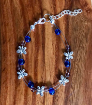 resell for 21.00 or more Floating pewter butterfly bracelet 7.5 inch plus ext blue and purple glass Made by Ashley Style #BFBBP103018