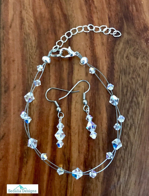 "20.00 resell for 60.00 or more Swarovski crystal. April Birthstone Diamond crystal w Clear AB  7.5"" plus ext Bracelet and Earring set Surgical steel ear wires Made by Ashley  Style #APRSBFBS110118"