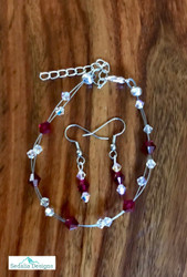 "20.00 resell for 60.00 or more Swarovski crystal. June Birthstone Ruby  crystal w Clear AB  7.5"" plus ext Bracelet and Earring set Surgical steel ear wires Made by Ashley  Style #JULBSFBS110218"