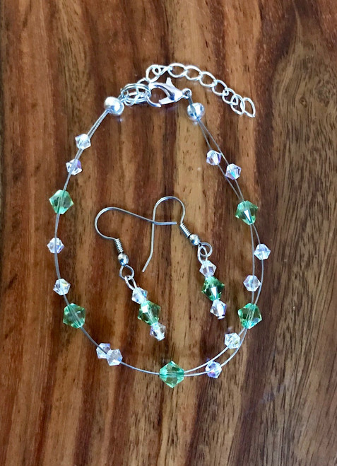 "20.00 resell for 60.00 or more Swarovski crystal. August Birthstone Peridot crystal w Clear AB  7.5"" plus ext Bracelet and Earring set Surgical steel ear wires Made by Ashley  Style #AUGSCFBS110218"