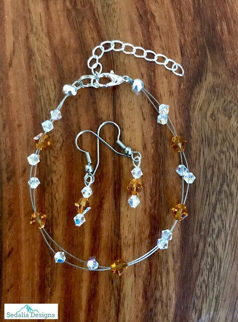 """20.00 resell for 60.00 or more Swarovski crystal. November Birthstone Topaz crystal w Clear AB  7.5"""" plus ext Bracelet and Earring set Surgical steel ear wires Made by Ashley  Style #NOVSBFBS110218"""