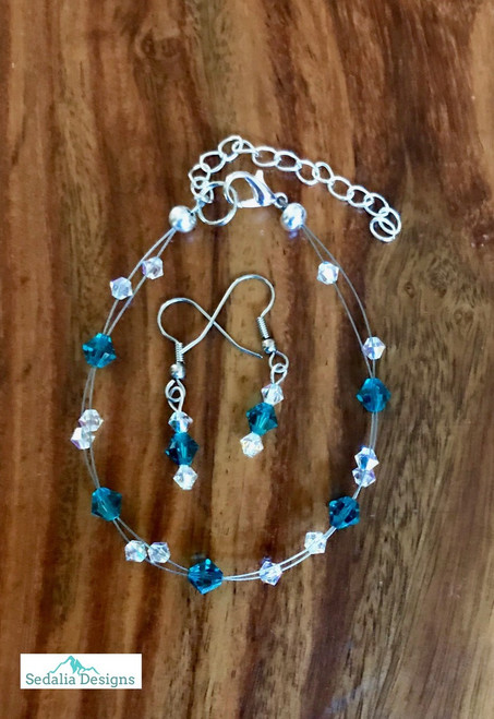 "Only at Website 20.00 resell for 60.00 or more Swarovski crystal. December Birthstone Turquoise crystal w Clear AB  7.5"" plus ext Bracelet and Earring set Surgical steel ear wires Made by Ashley  Style #DECSFBS110218"