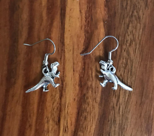 Resell for 6.00 or more Pewter dinosaur  Surgical steel ear wires Style #PDE110318