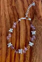 resell for 24.00 or more 7.5 inch floating bracelet plus ext chain pink glass/ pewter butterfly Made by Ashley  Style #PGFBB120318