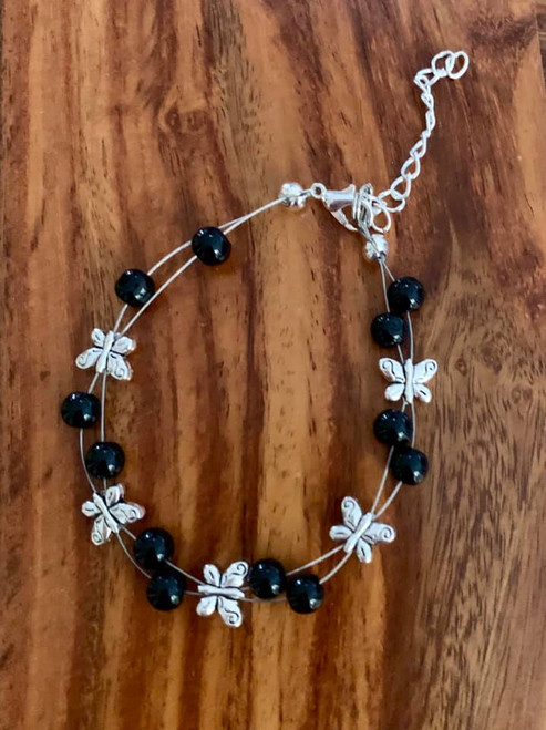 resell for 24.00 or more  7.5 inch floating bracelet plus ext chain black glass/ pewter butterfly Made by Ashley  Style #BGFBB120318