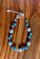 resell for 24.00 or more 7.5 inch floating bracelet plus ext blue white brown ceramic bead with blue glass pearl Made by Ashley  Style # BGPFB120318