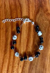 resell for 24.00 or more  7.5 inch floating bracelet plus ext black white ceramic bead with black glass  Made by Ashley  Style #BWCFB120318