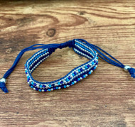 Resell for 36.00 or more Fits 7-9 inch bracelet Boho style/macrame  knot/ waxed cotton cord silver plated steel, glass. Multi blue Style #BMBB120618