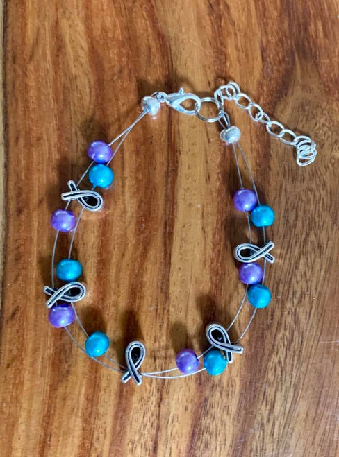 "Resell for 24.00 or more 7.5"" floating bracelet plus ext Purple and teal glass pearls Awareness bracelet Style #TPAFB010219"
