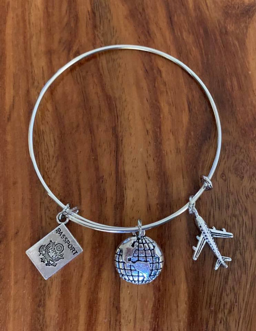 """Resell for 18.00 or more Fits up to 8"""" wrist / silver tone  Bauble bracelet / pewter travel  charms / passport / globe/ airplane Style #TBB010418"""