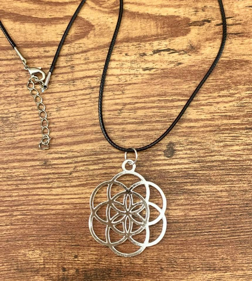 "resell for 12.00 or more 20 inch woven satin cord plus ext chain Plated pewter seed of life pendant 1 5/8"" x 1 3/8"" Style #SLPN013119"