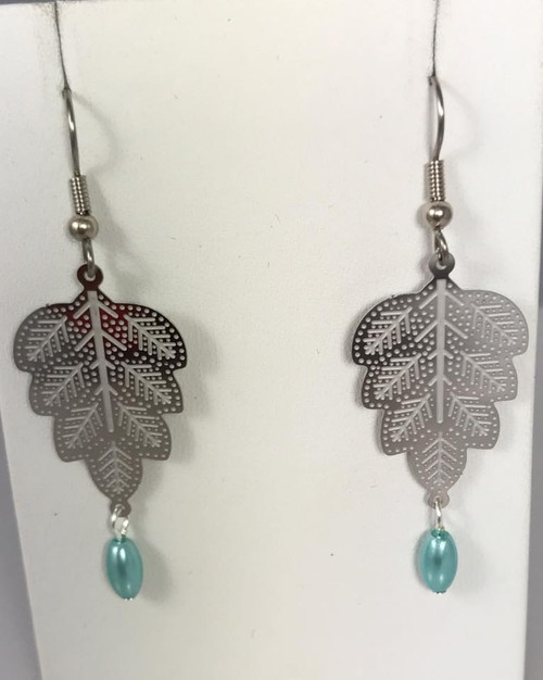 Resell for 15.00 or more Laser lace leaf with lt teal glass pearl Surgical steel ear wires Style #LLLLTP020219