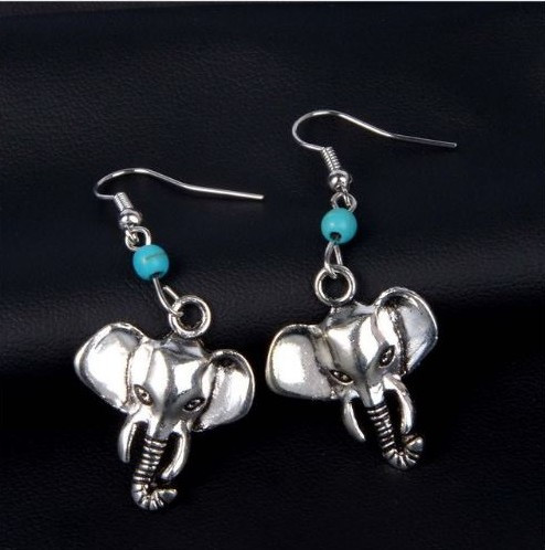 """resell for 15.00 or more Pewter elephant, turquoise magnesite 1.5"""" long Style #TMEE022819"""