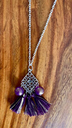 """5.00 resell for 15.00 or more 30"""" silver tone chain. Pendant is pewter with purple and gold tassels and beads. 2.5"""" long Boho Chic  Style #PGTPN031918"""
