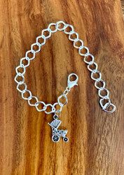 "$4.00 resell for $12.00 or more Pewter baby carriage charm bracelet great for adding charms to. Great Baby shower gift! 3/4"" x 2/4"" charm Silver plated bracelet fits up to 8"" Style #BCCB032019"